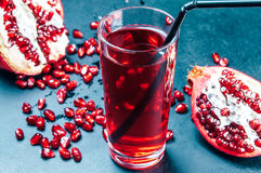 Pomegranate juice on blue table Stock Photo