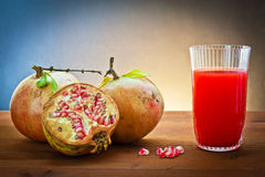 Pomegranate and juice drink Stock Photos