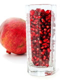 Pomegranate juice in a glass. Closeup on a white background stock photos