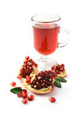 Pomegranate juice in a glass and fresh fruit Royalty Free Stock Photography