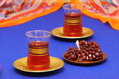 Pomegranate juice. Glass of pomegranate juice with fresh fruits Shallow DOF stock photography