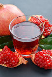 Pomegranate juice in glass Royalty Free Stock Photos