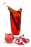 Pomegranate juice. In a glass Isolated on white background royalty free stock photo