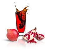 Pomegranate juice. In a glass Isolated on white background Royalty Free Stock Image