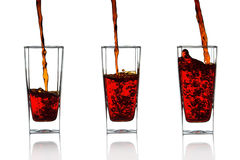 Pomegranate juice. In a glass Isolated on white background royalty free stock photos