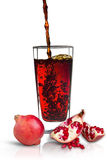 Pomegranate juice. In a glass Isolated on white background Royalty Free Stock Images