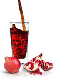 Pomegranate juice. In a glass Isolated on white background Stock Photos