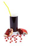 Pomegranate juice in a glass and ripe pomegranate. Royalty Free Stock Photography