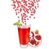 Pomegranate juice in a glass and ripe pomegranate. Isolated on white background. Close-up. Studio photography Stock Image