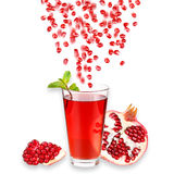 Pomegranate juice in a glass and ripe pomegranate. Isolated on white background. Close-up. Studio photography Royalty Free Stock Photo
