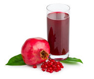 Pomegranate juice in a glass and ripe pomegranate Royalty Free Stock Images