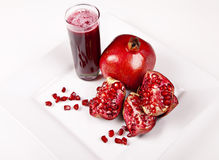 Pomegranate and juice in glass Stock Photos