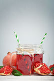Pomegranate juice in jar Stock Images
