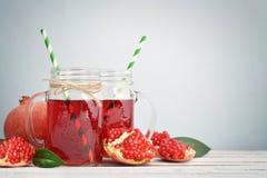 Pomegranate juice in jar Stock Photos