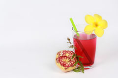 Pomegranate juice and peeled ripe  pomegranate on white background. Pomegranate juice is popular healthy food for diet and reduce heart disease risk as well as Royalty Free Stock Image
