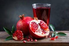 Pomegranate juice with pomegranate Royalty Free Stock Photos