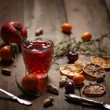 Pomegranate juice with pomegranates and dried fruits on a wooden table. Country style royalty free stock image