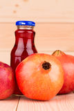 Pomegranate juice with pomegranates Stock Photography