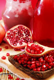 Pomegranate juice with red background Royalty Free Stock Photography