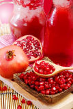Pomegranate juice with red background Stock Image