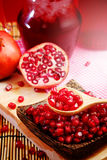 Pomegranate juice with red background Royalty Free Stock Images