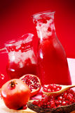 Pomegranate juice with red background Stock Photography