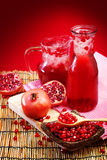 Pomegranate juice with red background Royalty Free Stock Photo