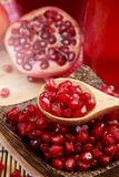 Pomegranate juice with red background Royalty Free Stock Image