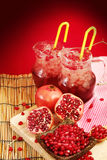 Pomegranate juice with red background Stock Photos