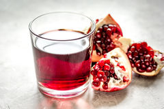 Pomegranate juice with seed on stone table background Stock Photo