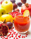 Pomegranate juice with seeds Royalty Free Stock Image