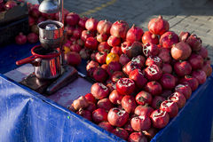 Pomegranate juice seller bench closeup. Horizontal image Stock Image