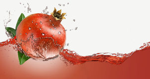 Pomegranate juice in a spray Stock Photography