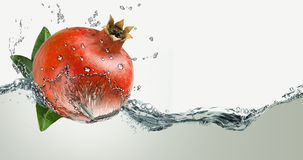 Pomegranate juice in a spray Stock Images