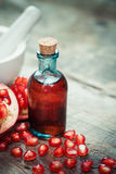 Pomegranate juice or tincture and garnet fruit with seeds Royalty Free Stock Photos