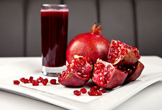 Pomegranate and juice Stock Images