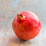 Pomegranate. Juicy and fresh pomegranate on a wooden base. Pomegranate stock image. Healthiest fruit pomegranate stock image royalty free stock images