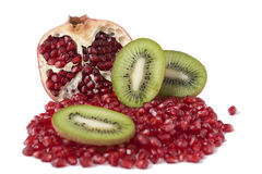Pomegranate and kiwi Stock Photos