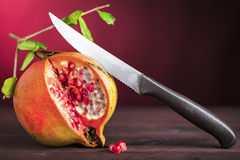 Pomegranate and knife Stock Photo