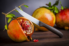 Pomegranate and knife Royalty Free Stock Image