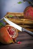 Pomegranate and knife Royalty Free Stock Photo