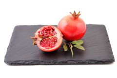 Pomegranate with leaves. Stock Photo