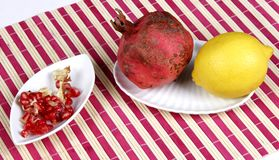 Pomegranate and lemon Royalty Free Stock Images