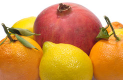 Pomegranate, lemons and oranges with leaves isolat Royalty Free Stock Photography