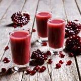 Pomegranate liqueur with cream Stock Photos