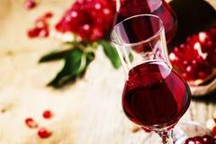 Pomegranate liqueur, vintage wooden background, selective focus stock images