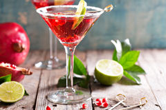 Pomegranate martini with lime Royalty Free Stock Photos