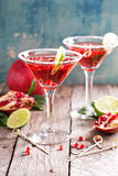 Pomegranate martini with lime Royalty Free Stock Images