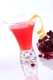 Pomegranate martini - Most popular cocktails serie. Closeup of Pomegranate martini and broken open pomegranate over white. Vodka, pomegranates juice and lemon stock photos