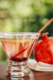 Pomegranate martinis. Pomegranate martini served outdoors in a natural environment Stock Photo
